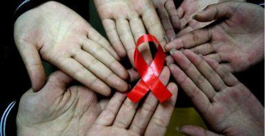 Porque o laço vermelho como símbolo da luta contra a AIDS
